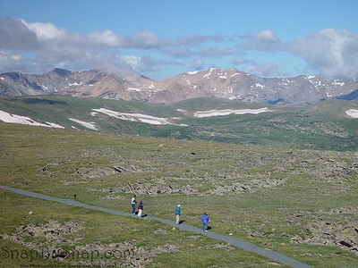 Other photographers take in the scene at Rocky Mountain National Park.