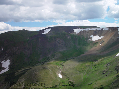 Snow fields cling to the tundra in this summer time image from the top of Rocky Mountain National Park.