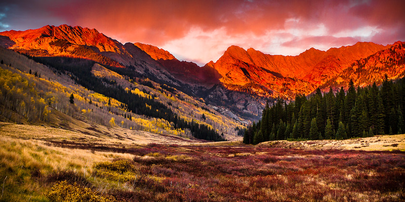 The Gore Range on fire with the evening sunset.
