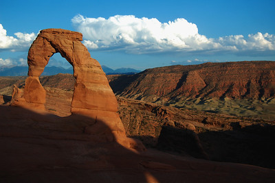 """The famous Delicate Arch photo seen worldwide. When you go, take the time to stand underneath the arch. It is then you realize just how tall it really is. It's like standing under a skyscraper. If you go around sunset be prepared for a crowd of people looking for that """"perfect"""" sunset picture.  It's a bit of a hike to get there, but it's worth the view."""