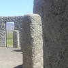Peering through the Stonehenge war memorial at wind turbines in the hills to the east/northeast.  May 20.