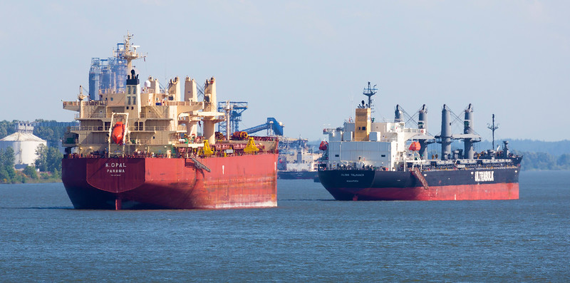 Two more unloaded bulk carriers make their way upstream.