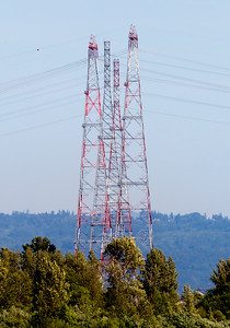 High voltage transmission towers line the River, carrying power from the many dams.