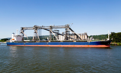 The 39,000-gross-ton Ourania Luck is loading grain.