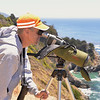 Our Ventana Wildlife Society guide uses a spotting scope to identify condors on the beach.  He logs condor sightings every day.