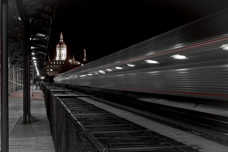 A train pulling into Union Station in the evening.  Day~108