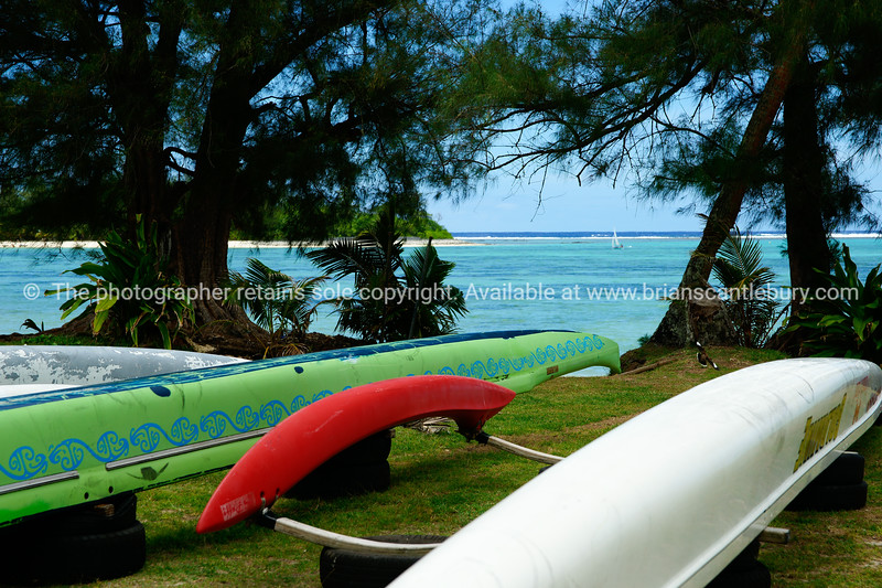 """Sights of the Cook Islands. Tropical paradise in the south Pacific. Vaka canoes and lagoon view through trees. Please preview book """"Cook Islands"""", above.  <a href=""""http://www.blurb.com/b/1907535-cook-islands"""">http://www.blurb.com/b/1907535-cook-islands</a>"""