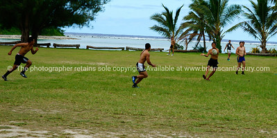 """Rugby, Cook Islanders pass the ball. Model released; no, for editorial & personal use. Please preview book """"Cook Islands"""", above. www.blurb.com/b/1907535-cook-islands"""