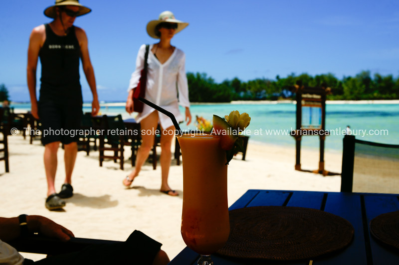 """Sights of the Cook Islands. Tropical paradise in the south Pacific.<br /> Tourists home in on beachside restaurant.<br /> Model released; no, for editorial & personal use. Please preview book """"Cook Islands"""", above.  <a href=""""http://www.blurb.com/b/1907535-cook-islands"""">http://www.blurb.com/b/1907535-cook-islands</a>"""