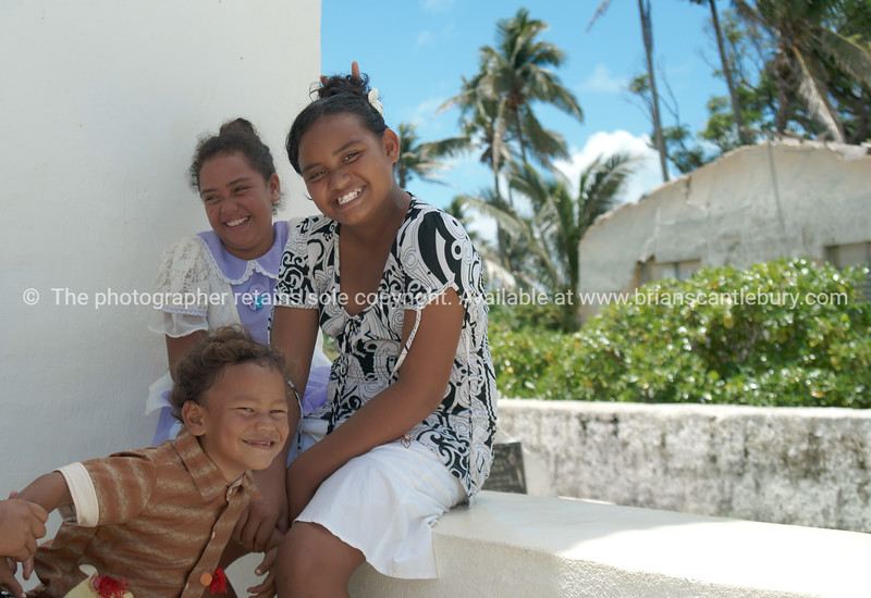 "Happy, children outside the CICC church on Aitutaki, Cook Islands.<br /> Model released; no, for editorial & personal use. Please preview book ""Cook Islands"", above.  <a href=""http://www.blurb.com/b/1907535-cook-islands"">http://www.blurb.com/b/1907535-cook-islands</a>"