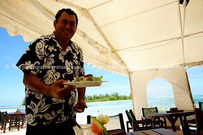 """Sights of the Cook Islands. Tropical paradise in the south Pacific. Charlie provides the service with a characteristic smile. Model released; no, for editorial & personal use. Please preview book """"Cook Islands"""", above. www.blurb.com/b/1907535-cook-islands"""