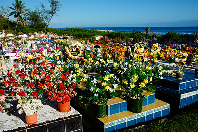 """Rarotonga cemetery, bestowed with flowers following the All Souls Day tributes. Cook Islands. Please preview book """"Cook Islands"""", above. www.blurb.com/b/1907535-cook-islands"""