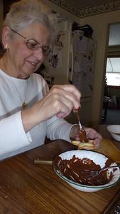 Mom spreading the chocolate.