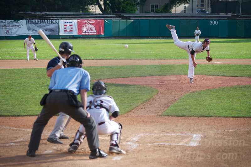 Cooperstown Hawkeyes pitcher Dean White (from Post University (CT) ) pitches on July 3 against the Elmira Pioneers.<br /> Catcher Nicholas LaForgia from Franklin Pierce University