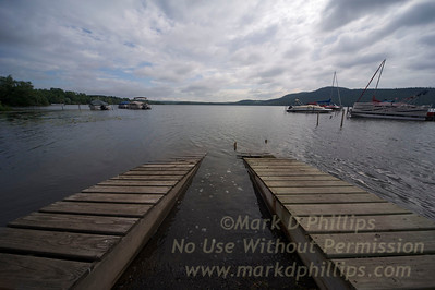 Docks vanish at Lake Otsego from the lakeside at the Lake N Pines Motel in Cooperstown, New York for travel story. Lake was incredibly high from rain.