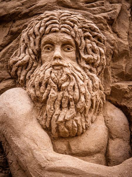 Arkaisk rasta mand i sandet
