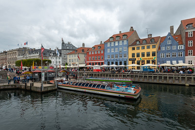 Canal and Harbor Tours of Copenhagen. Mindeankeret, København, Denmark. Popular destination featuring colorful 17th- & 18th-century townhouses on a canal with wooden ships.