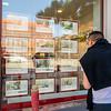 Copenhagen, Denmark, Chinese Man Looking in Real Estate Office Shop WIndow, Frederiksberg