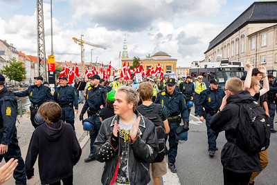 Copenhagen, Denmark, Danish Police Seperating Leftist Demonstrators, protesting in favor of Migrants, and a demonstration of the extreme right, Danish anti-immigration group MArching on Street