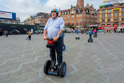 Copenhagen, Denmark, Touristst riding Segway People Movers on Town Square