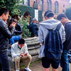 Copenhagen, Denmark, Crowd of Danish Teenagers Playing Smart Phone Game Pokemon Go in Public Park