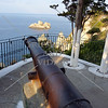 A canon overlooking a view outside the Monastery of Virgin Mary near the Paleokastritsa village in Greece.