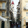 A view of building architectures and narrow shopping street in Corfu, Greece.