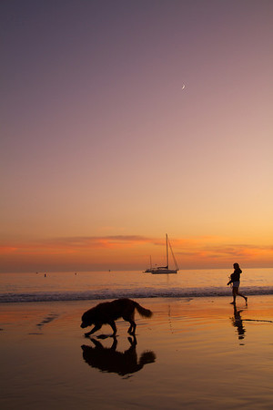 The classic California shot.  Golden Retriever, sailboat, stroll on the beach, and the moon contrasted with the setting sun.  This one is my favorite in the gallery.