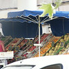 One of the fruit and vegetable vendors.
