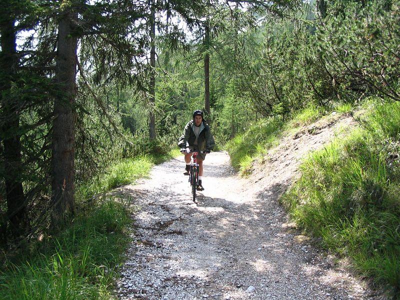 Kostadis biking in the woods.