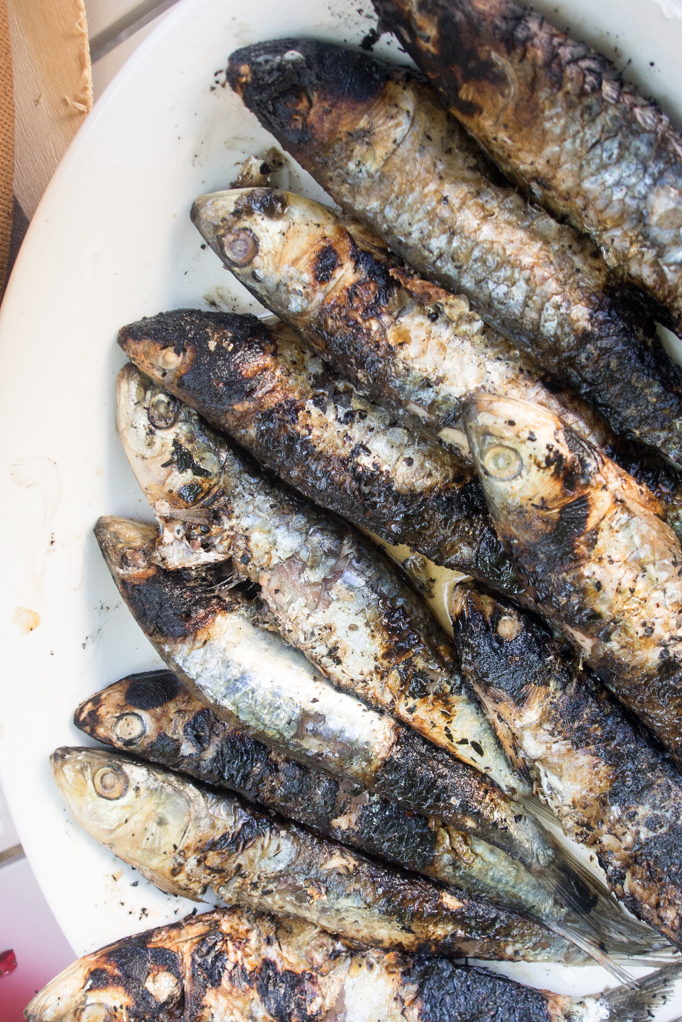 Grilled sardines are the perfect compliment to Vinho Verde red wine, learn more about this underrated wine.