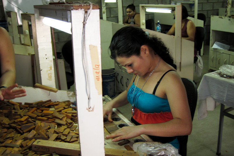 They do not waste anything.  This girl is sorting small pieces that get graded and then sent out to independent craftswoman who then return the products for sale here.<br /> <br /> 246-IMG_9157
