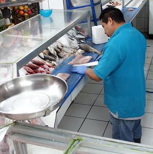 Fish monger. San Jose market