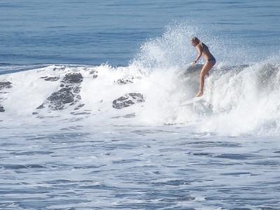 Surfer on the Pacific coast near Jaco, Costa Rica