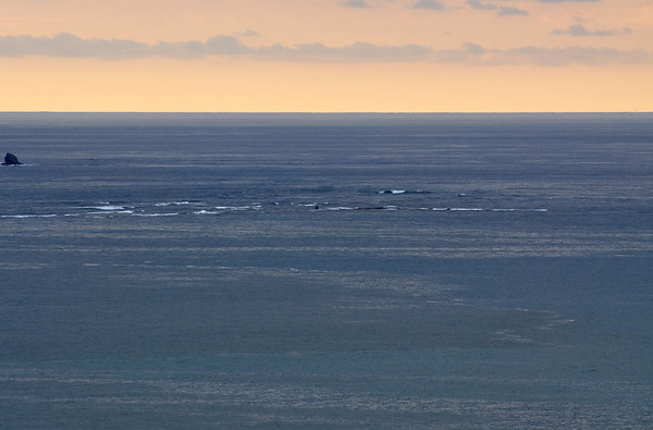 This image was also captured from the patio of our La Cusinga room. The late afternoon, early evening, image shows that large rock cube out on the whale tail. Notice toward the right of the image from the rock cube that the land bridge is gone.