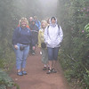 Trying to stay warm and dry on the hike to the volcano. In the clouds.