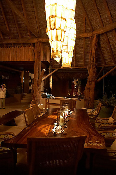 The outdoor dining table was made out of two pieces of teak.<br /> <br /> Imagine the whole outdoor living area is facing the ocean. WOW!
