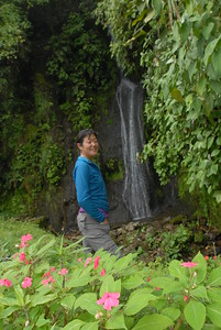 © Joseph Dougherty. All rights reserved.   Tina with Impatiens and waterfall.