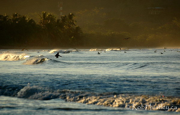 Fisherman at dawn on Playa Samara, Costa Rica.  © Rob Huntley