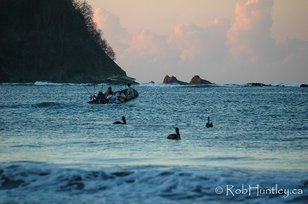 Fishing party leaving Playa Samara in the early morning. Costa Rica.