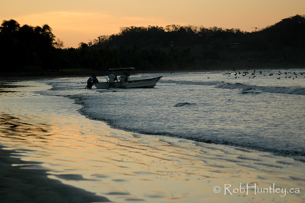 Early morning fishing party setting off from Playa Samara. Costa Rica.