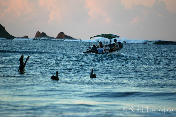 Fishing party leaving Playa Samara in the early morning. Costa Rica.  © Rob Huntley