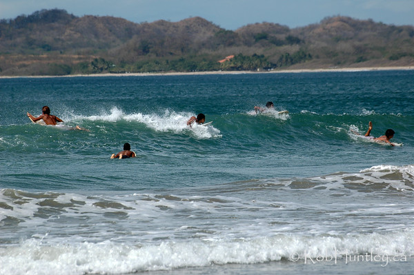 Surfers at Playa Tamarindo, Tamarindo, Costa Rica.