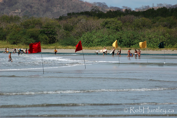 Beach flags at Playa Tamarindo, Tamarindo, Costa Rica.