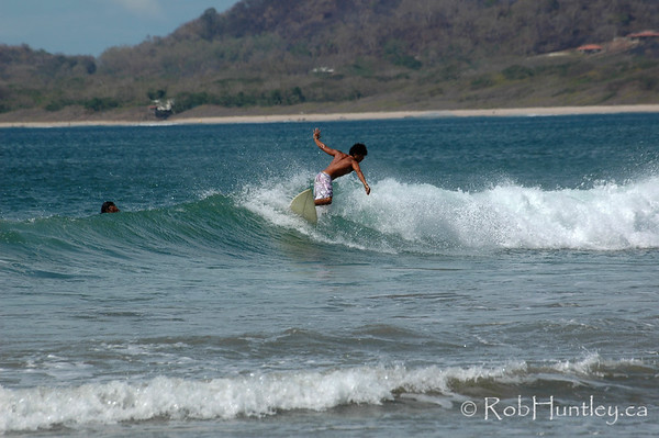 Surfer at Playa Tamarindo, Tamarindo, Costa Rica. © Rob Huntley