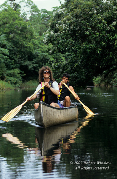 Model Released, Guide and tourist in a Canoe, Lake Coter, Rain Forest Vegetation, Lake Coter Eco Lodge, Private Biological Reserve, Northern Pacific Mountains, Arenal Lake Region, Costa Rica, Central America
