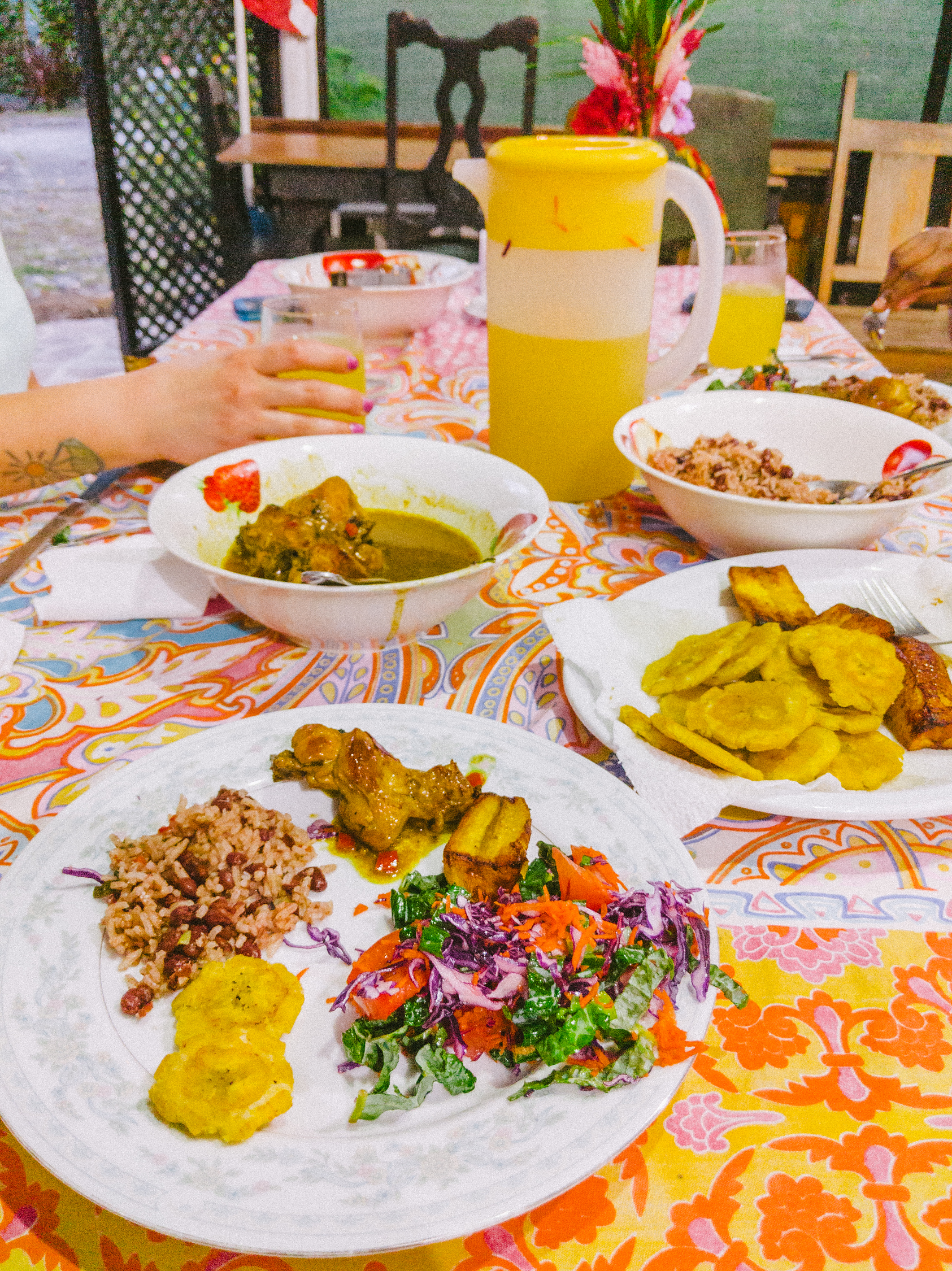 Traditional meal in Puerto Viejo Costa Rica with Caribbean rice and beans, patacones and chicken in Caribbean sauce.