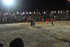 bullfight with rider going down