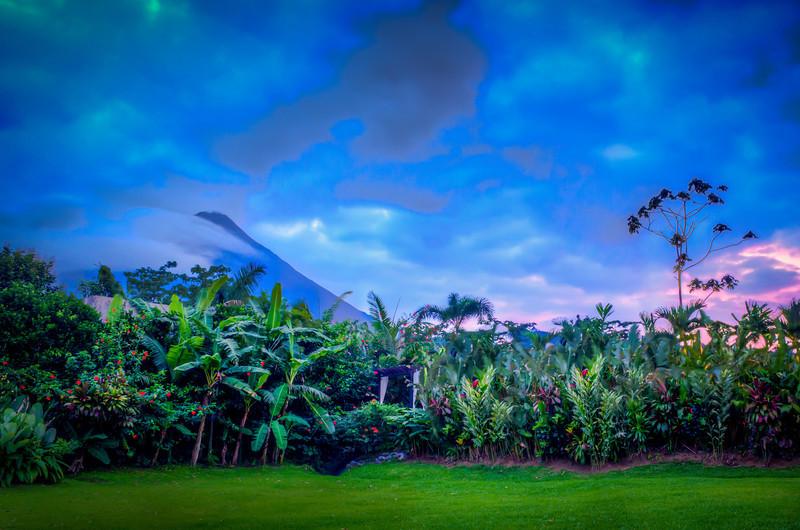 Clouds surround Arenal Volcano as dusk descends. LaFortuna, Costa Rica.