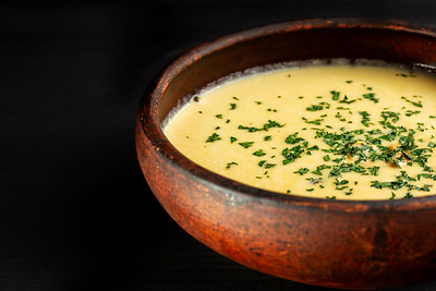 Roasted Pumpkin Soup With Cream On Black Wooden Background.